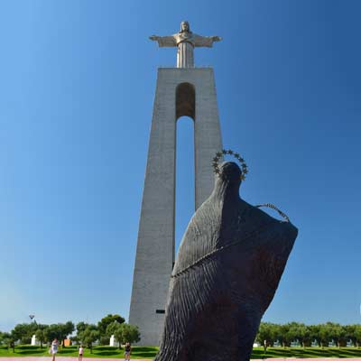 Image result for Cristo-Rei (Christ the King) monument overlooking Lisbon.